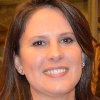 Natalie Wells, Director