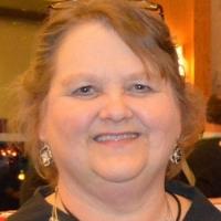 Tina Squires, Director - Former President
